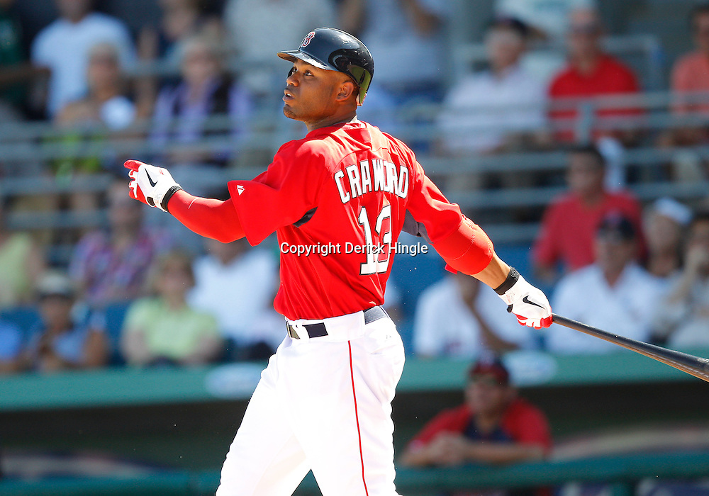 February 28, 2011; Fort Myers, FL, USA; Boston Red Sox left fielder Carl Crawford (13) during a spring training exhibition game against the Minnesota Twins at City of Palms Park.  Mandatory Credit: Derick E. Hingle