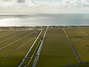 Nederland, Friesland, Gemeente Sudwest-Fryslan (Zuidwest-Friesland), 16-04-2012. Ten noordwesten van Workum, Polder Geele Strand en grenzend aan het IJsselmeer het natuurreservaat de Workumerwaard.Polder near the IJssel lake (IJsselmeer) in Friesland..luchtfoto (toeslag), aerial photo (additional fee required);.copyright foto/photo Siebe Swart