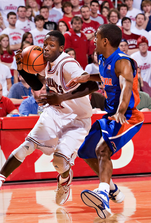 FAYETTEVILLE, AR - FEBRUARY 2:   Patrick Beverly #21 of the Arkansas Razorbacks dribbles to the basket during a game against the Florida Gators at Bud Walton Arena on February 2, 2008 in Fayetteville, Arkansas.  The Razorbacks defeated the Gators 80-61.  (Photo by Wesley Hitt/Getty Images) *** Local Caption *** Patrick Beverly