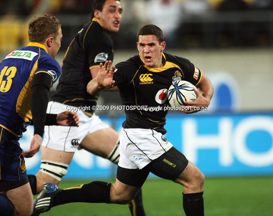 Wellington second five Shaun Treeby prepares to fend off Otago's Brett Mather as he breaks to set up the supporting Daniel Ramsay's try.<br /> Air NZ Cup Ranfurly Shield match - Wellington Lions v Otago at Westpac Stadium, Wellington, New Zealand. Friday, 31 July 2009. Photo: Dave Lintott/PHOTOSPORT