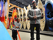 "Zariah, 5, pretends to paddle a boat as Atlanta Falcons player Jerome Smith laughs as they shopped for toys and gifts during the ""Shop with a Pro"" event hosted by the the Atlanta Falcons and the Atlanta Falcons Rookie Club at the Mall of Georgia Dick's Sporting Goods in Buford. The program allowed disadvantaged and homeless children to bond while shopping with members of the Falcons during the holidays. (Staff Photo: David Welker)"
