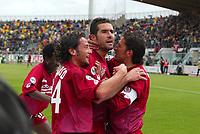 Livorno 17-4-05<br />Livorno Fiorentina Campionato serie A 2004-05<br />nella  foto Lucarelli festeggia dopo il suo gol con Grauso e Protti<br />Foto Snapshot / Graffiti