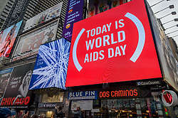 December 1, 2018 - New York, New York, United States - ACT UP New York took to the streets on December 1, 2018 to draw attention to World AIDS Day, an international recognition of the HIV/AIDS epidemic. ACT UP NY staged a speak out in Times Square to emphasize: people with HIV and AIDS are still here fighting for the end of the AIDS epidemic in New York, the US, and around the world. The action was followed by the Out of Darkness candlelight vigil and march at the NYC AIDS Memorial to remember those lost on World AIDS Day. (Credit Image: © Erik Mcgregor/Pacific Press via ZUMA Wire)
