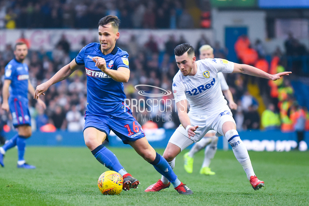 Paweł Olkowski of Bolton Wanderers (16) is hassled by Jack Harrison of Leeds United (22) during the EFL Sky Bet Championship match between Leeds United and Bolton Wanderers at Elland Road, Leeds, England on 23 February 2019.