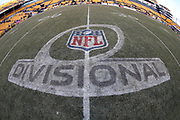 The NFL Divisional Playoff logo painted on the field grass is torn up by cleats after the Pittsburgh Steelers NFL 2018 AFC Divisional playoff football game against the Jacksonville Jaguars, Sunday, Jan. 14, 2018 in Pittsburgh. The Jaguars won the game 45-42. (©Paul Anthony Spinelli)