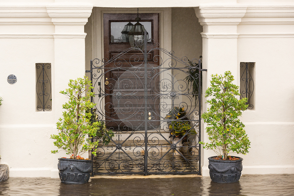 A historic estate home has floodwater lapping at the door along the Battery as Hurricane Joaquin brings heavy rain, flooding and strong winds as it passes offshore October 4, 2015 in Charleston, South Carolina.