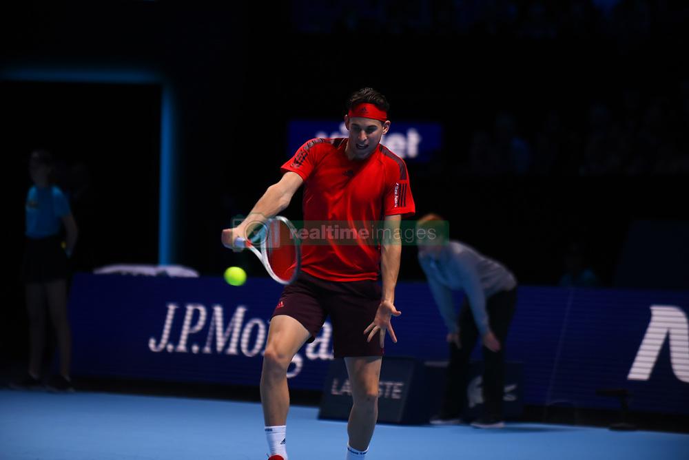 November 17, 2017 - London, England, United Kingdom - Austria's Dominic Thiem returns to Belgium's David Goffin during a men's singles round-robin match on day six of the ATP World Tour Finals tennis tournament at the O2 Arena in London on November 17, 2017. (Credit Image: © Alberto Pezzali/NurPhoto via ZUMA Press)