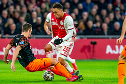 Sergino Dest #28 of Ajax, Nick Viergever #4 of PSV Eindhoven in action during the match between Ajax and PSV at Johan Cruyff Arena on February 02, 2020 in Amsterdam, Netherlands