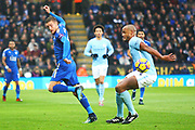 Leicester City forward Jamie Vardy (9) passes with a back-heel past Manchester City defender Vincent Kompany (4) during the Premier League match between Leicester City and Manchester City at the King Power Stadium, Leicester, England on 18 November 2017. Photo by John Potts.