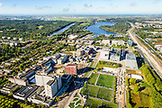 Nederland, Noord-Holland, Amsterdam, 27-09-2015; Zuid-as, overzicht campus van de Vrije Universiteit (VU) aan de Boelenlaan. Hoofdgebouw van de VU met links de subfaculteiten natuurwetenschappen en het Opleidingsinstituut Zorg en Welzijn (OZW). In de achtergrond Academisch Ziekenhuis Vrije Universiteit VUmc, VUmc Cancer Center, ACTA (tandheelkunde). Nieuwe Meer en Schiphol aan de horizon.<br /> Zuid-as, 'South axis', financial center in the South of Amsterdam, with University Vrije Universiteit). <br /> University Hospital VUmc (Vrije Universiteit) and VU MC Cancer Center. Amsterdam equivalent of 'the City', financial district. <br /> luchtfoto (toeslag op standard tarieven);<br /> aerial photo (additional fee required);<br /> copyright foto/photo Siebe Swart