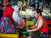 03 AUGUST 2017 - KUTA, BALI, INDONESIA: Workers in the Kedonganan fish market on Jimbrana Beach in Kuta. The beach is close to the airport and a short drive from other beaches in southeast Bali. Jimbrana was originally a fishing village with a busy local market. About 25 years ago, developers started building restaurants and hotels along the beach and land prices are rising. The new emphasis on tourism is changing the nature of the area but the fishermen are still busy very early in the morning.     PHOTO BY JACK KURTZ