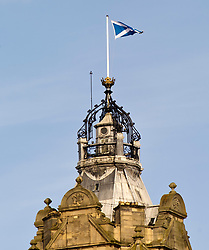 Pictured: The saltire above the Balmoral on Edinburgh's Princes Street flies over a city considering the impact of a second independence referendum<br /> <br /> Ger Harley | EEm 15 March 2017