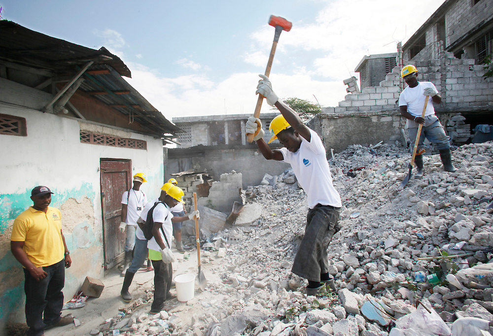 Workers remove debris from the site of a collapsed home as part of a rubble removal project in the Port-au-Prince area of Bellaire, one the hardest hit neighborhoods in the earthquake that struck Haiti two years ago, Thursday, Jan. 5, 2012.  The project is managed by the United Nations Development Program and the NGO Viva Rio. (Photo/Stuart Ramson/Insider Images for UN Foundation)