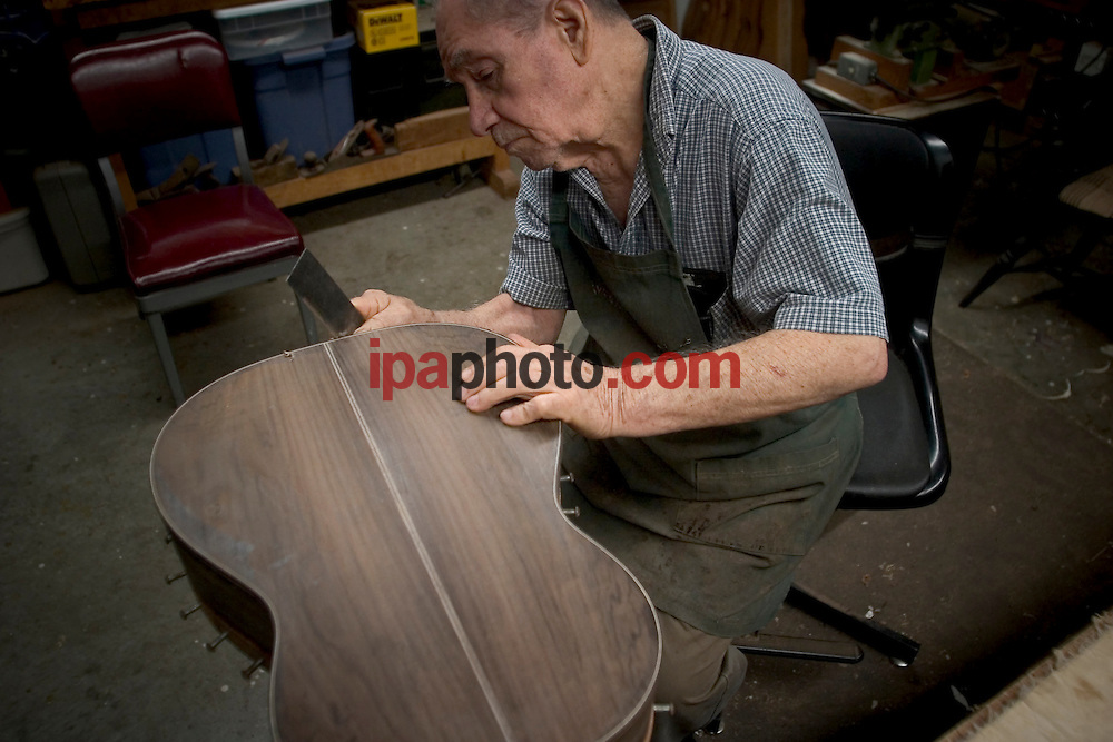 "April/12/2007. Winter Springs, Florida, USA. Manuel Velazquez, the most recognized ""luthier"" in the world outside of Europe, works in his shop in the city of Winter Springs, Florida. IPAPHOTO.COM...Abril/12/2007. Winter Springs, Florida, USA. Alfredo Velazquez, hijo de Manuel Velazquez, el ""Luthier"" mas reconocido en el mundo fuera de Europa, trabaja en su taller en la ciudad de Winter Springs, Florida. IPAPHOTO.COM."
