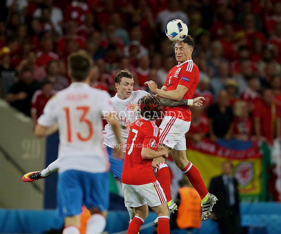 TOULOUSE, FRANCE - Monday, June 20, 2016: Wales' James Chester in action against Russia during the final Group B UEFA Euro 2016 Championship match at Stadium de Toulouse. (Pic by David Rawcliffe/Propaganda)