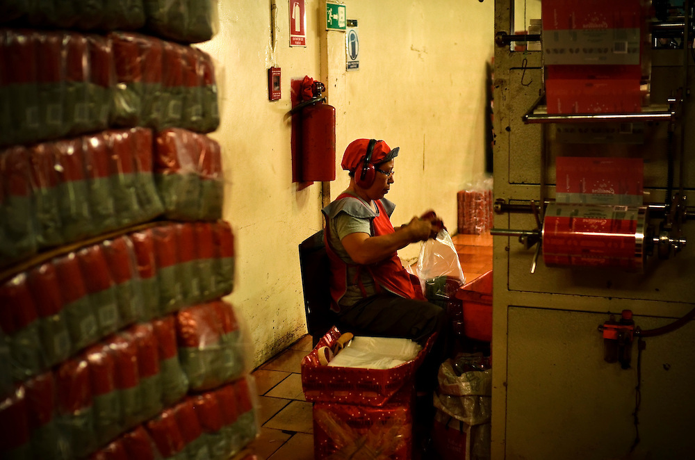 A worker packages coffee at Cafe Cordillera in Barquisimeto, Venezuela. The coffee factory has to import a lot of its coffee from Brazil, because local growers cannot fulfill their demand. State price controls on the sale of coffee have made it nearly impossible for growers to make a profit on their coffee crop. This year, it is expected that Venezuela will import more coffee than it produces.