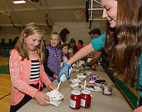 """Samantha Gray says """"yes"""" to whipped cream on her ice cream sundae at Laconia Summer Program's final day celebration at the Community Center on Wednesday afternoon.  (Karen Bobotas/for the Laconia Daily Sun)"""