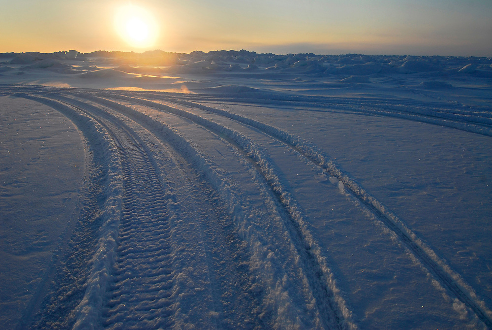 Barrow, Alaska. Snow machine tracks on the ice of the Arctic Ocean during Spring. May 2007