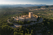 Ulldecona Castle, aerial view, at Ulldecona, Catalonia, Spain. The castle was built as an Andalusian fort under the Moors 8th - 11th centuries, then owned by the Montcada family of Tortosa, who in 1148 gave it to the Knights Hospitaller, when it became a Christian castle. A 16th century church, a 12th century circular watchtower and a 13th century square keep remain, built on top of the original Arabic fort and earlier Iberian settlements. Picture by Manuel Cohen