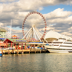 Navy Pier Chicago panoramic picture with the Ferris Wheel and tour boats along Lake Michigan. Panorama ratio is 1:3. Image Copyright © Paul Velgos All Rights Reserved.
