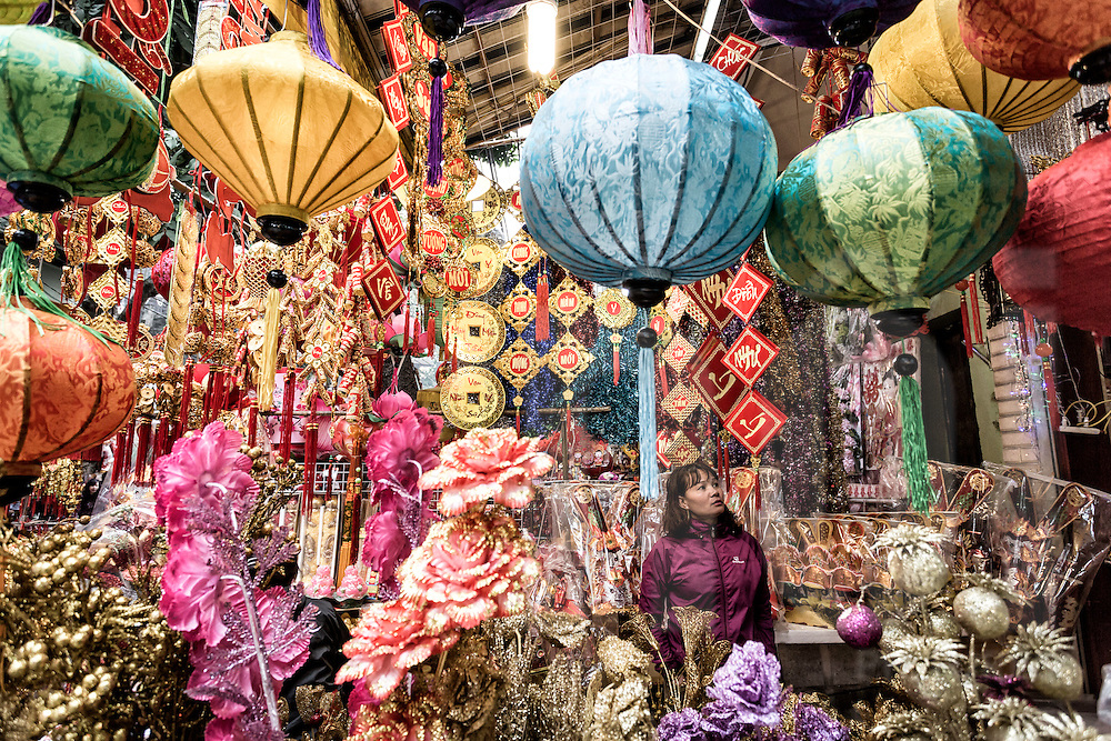 An abundance of colorful Tet decorations sold along Hang Ma Street in Hanoi's Old Quarter, Vietnam, Southeast Asia
