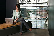 Cristina De la Fuente, lifestyle and business coach from Outsmarting Busyness, is pictured with her Apple Macbook at the Black DIamond (Den Sorte Diamant) in Copenhagen