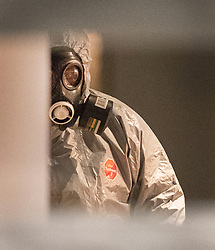 © Licensed to London News Pictures. 06/03/2018. Salisbury, UK. A policeman in a protective suit and gas mask is seen inside Zizzi's restaurant in Salisbury, Wiltshire, where former Russian spy Sergei Skripal and his daughter visited before becoming ill with suspected poisoning. The couple where found unconscious on bench in Salisbury shopping centre. Specialist units have been called in to deal with any possible contamination. Photo credit: Peter Macdiarmid/LNP