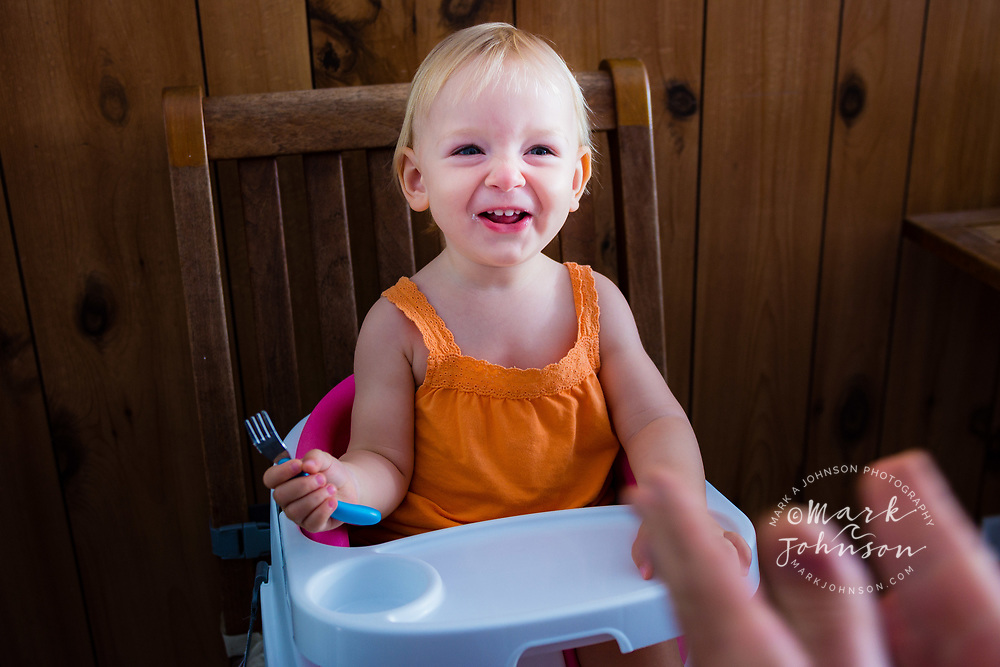 15 month old girl eating, Caloundra, Sunshine Coast, Queensland, Australia