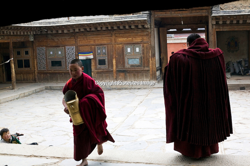 APRIL 5, 2012 : a young monk brings supplies to his olders during a prayer at Labrang monastery in the morning .