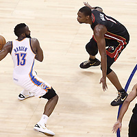 14 June 2012: Oklahoma City Thunder guard James Harden (13) looks to pass the ball past Miami Heat power forward Chris Bosh (1) during the Miami Heat 100-96 victory over the Oklahoma City Thunder, in Game 2 of the 2012 NBA Finals, at the Chesapeake Energy Arena, Oklahoma City, Oklahoma, USA.