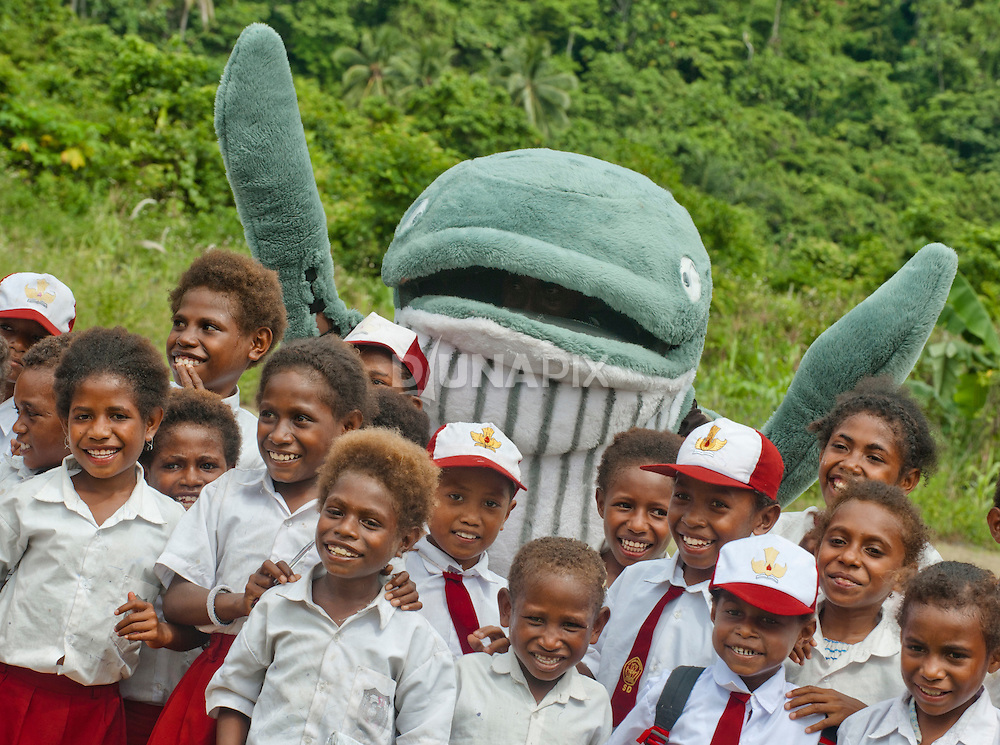 A Bryde's Whale mascot pays a visit to Lobo Village, getting school kids jazzed about conservaion in Triton Bay, Papua.