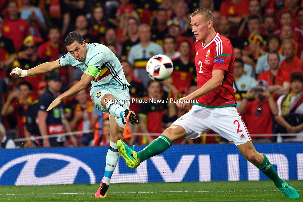 TOULOUSE, FRANCE - JUNE 26 : Eden Hazard midfielder of Belgium battles for the ball with ¡dam Lang defender of Hungary