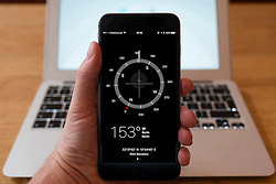 Using iPhone smartphone to display compass app