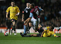 Photo: Rich Eaton.<br /> <br /> Aston Villa v Arsenal. The Barclays Premiership. 14/03/2007. John Carew of Aston Villa is tackled by Arsenal captain Gilberto