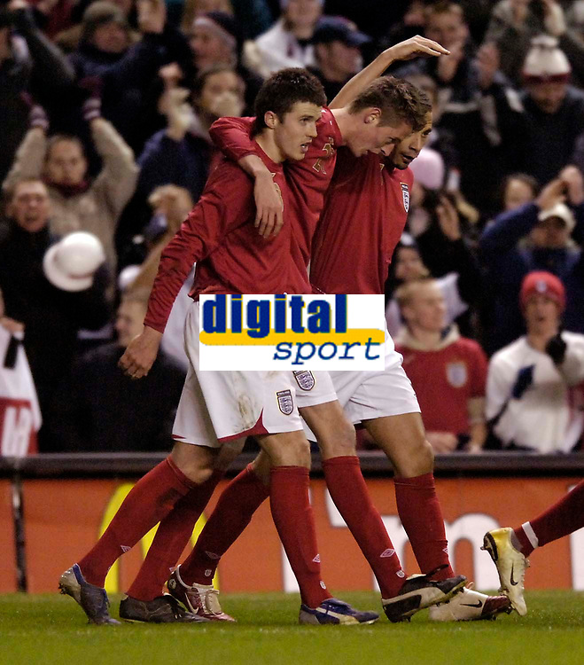 Photo: Jed Wee.<br /> England v Uruguay. International Friendly. 01/03/2006.<br /> <br /> England celebrate with Peter Crouch (C).