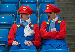 MANCHESTER, ENGLAND - Sunday, January 8, 2012: Two Manchester City supporters dressed as the Nintendo computer game character Mario during the FA Cup 3rd Round match against Manchester City at the City of Manchester Stadium. (Pic by David Rawcliffe/Propaganda)