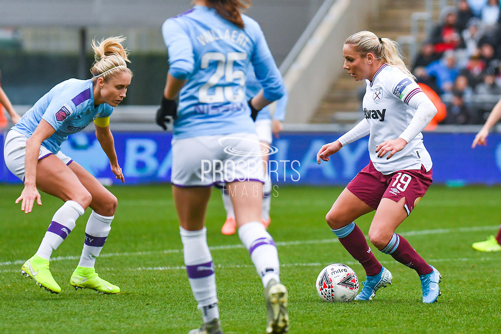 West Ham United Women forward Adriana Leon (19) and Manchester City Women defender Steph Houghton (captain) (6) in action during the FA Women's Super League match between Manchester City Women and West Ham United Women at the Sport City Academy Stadium, Manchester, United Kingdom on 17 November 2019.