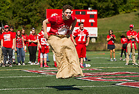 "Caden Perry gets a good jump for the Junior class during the ""sack race"" at Laconia High School's Homecoming Pep Rally Friday afternoon.  (Karen Bobotas/for the Laconia Daily Sun)"