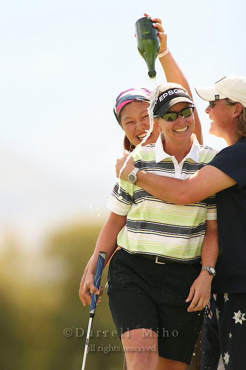 Apr. 2, 2006; Rancho Mirage, CA, USA; Christina Kim (left) pours champagne while Michelle Ellis (right) gives Karrie Webb (center) a hug after Webb won the Kraft Nabisco Championship on the first playoff hole at Mission Hills Country Club. ..Mandatory Photo Credit: Darrell Miho.Copyright © 2006 Darrell Miho .
