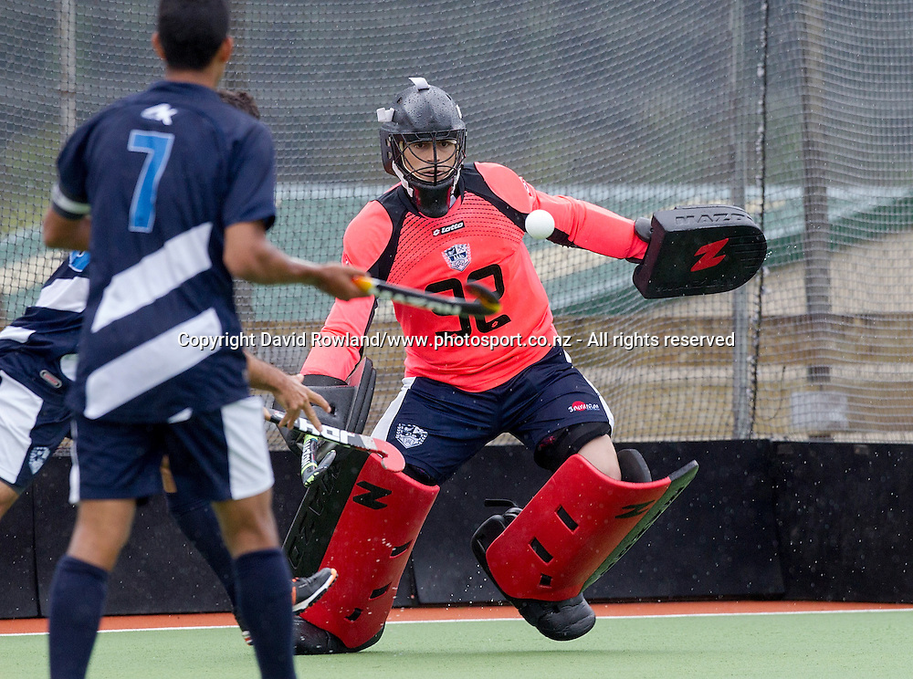 Auckland`s goalkeeper Devon Manchester makes a save in the Auckland v Southern Men`s semi-final match, Ford National Hockey League, North Harbour Hockey Stadium, Auckland, New Zealand,Saturday, September 13, 2014. Photo: David Rowland/Photosport