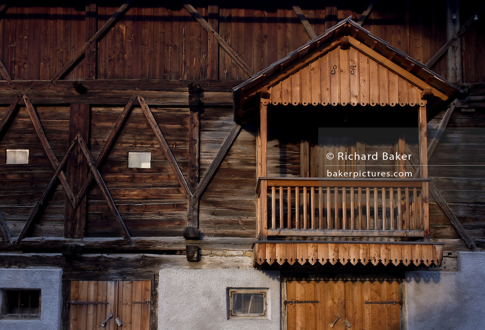 Typical Tyrolean timber barn architecture in Leonhard-St Leonardo, a Dolomites village in south Tyrol, Italy.