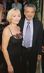 MR & MRS GULU LALVANI at a party in London on 22nd June 1998.MIR 20