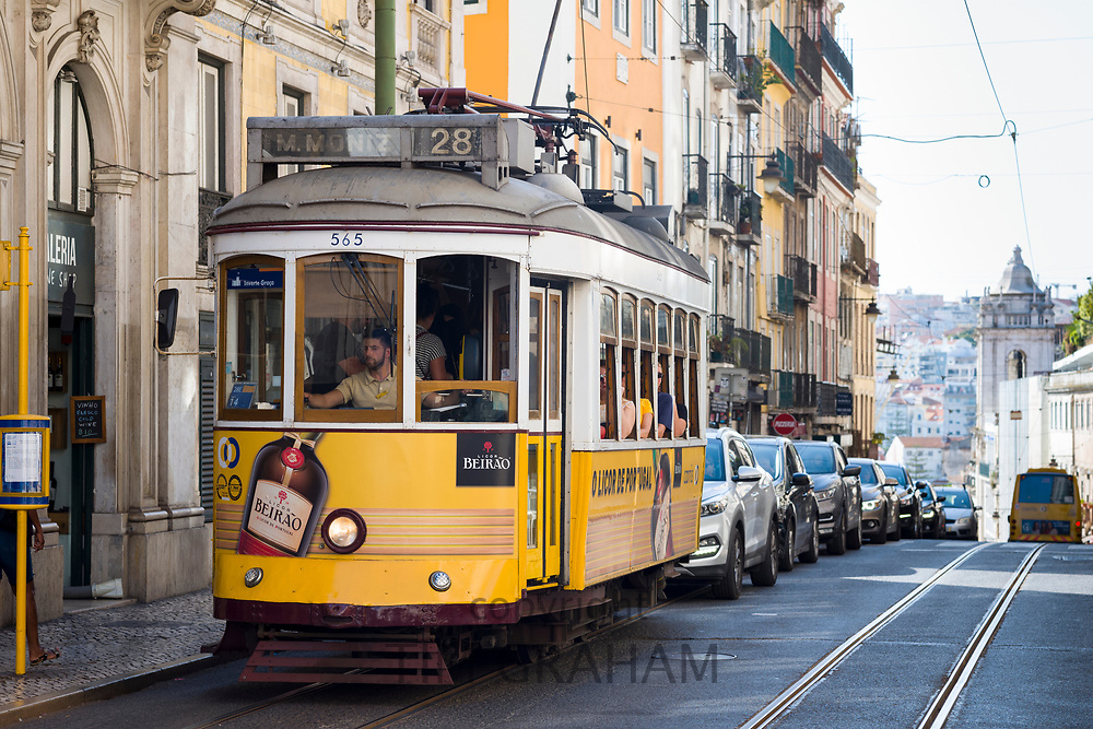 Famous tram no. 28 carrying local people and tourists on tram tracks ii Praca Luis de Camoes n City of Lisbon, Portugal