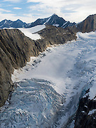 Aerial view of a glacier and the Alaska Range on a sightseeing flight from Talkeetna, Alaska.