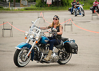 Riders leave the parking lot at Faro Italian Grille on Saturday morning for the 13th annual Brenda's Ride with Friends.  Proceeds to benefit the LRGHealthcare Oncology Department. (Karen Bobotas/for the Laconia Daily Sun)