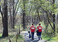 Luke Gatewood, 11, and Karen Gatewood of Levittown , Pennsylvania carry trash bags as they participate in Earth Day Work Day to clean up the area Saturday April 16, 2016 at Silver Lake Nature Center in Bristol, Pennsylvania. (Photo by William Thomas Cain)