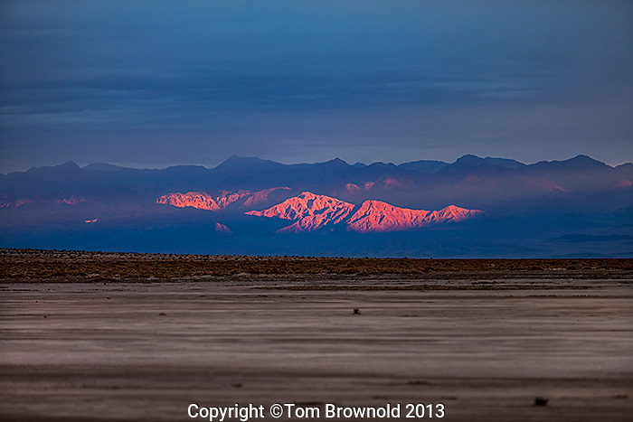 A winter storm moving effecting the sunrise over t the Grapevine Mountains. Image made from the Middle Basin of Death Valley and Salt Creek.