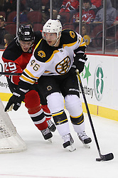 Jan 19; Newark, NJ, USA; Boston Bruins center David Krejci (46) skates with the puck while being defended by New Jersey Devils defenseman Mark Fayne (29) during the first period at the Prudential Center.