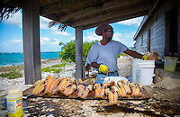 Island Harbor, Anguilla - January, 2015: Cleaning lobsters at Scilly Cay in Anguilla. Scilly Cay is a small island in Island Harbor where patrons, after hailing a free water taxi by waving from the dock, can eat, drink and swim in the pristine waters that surround the island. CREDIT: Chris Carmichael for The New York Times