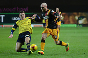 Oxford United midfielder Joshua Ruffels (14) tackles Bradford City midfielder Nicky Law (4) 0-0 during the EFL Trophy match between Oxford United and Bradford City at the Kassam Stadium, Oxford, England on 31 January 2017. Photo by Alan Franklin.